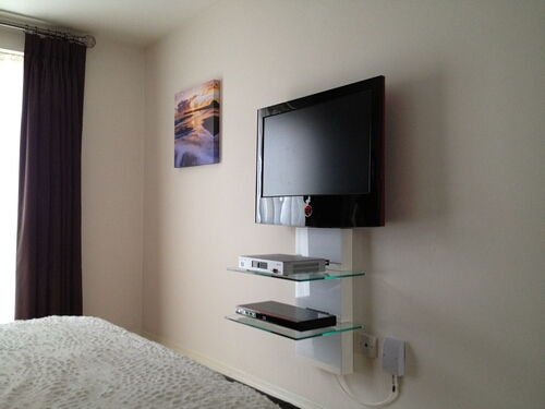 Standard TV Wall Installation with Floating Shelves
