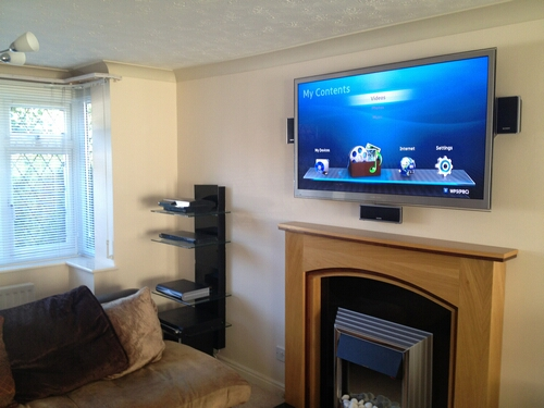 TV above Fireplace with Hidden Cabling Service