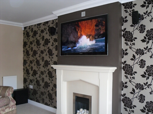TV Mounted above Fireplace Hidden Cabling