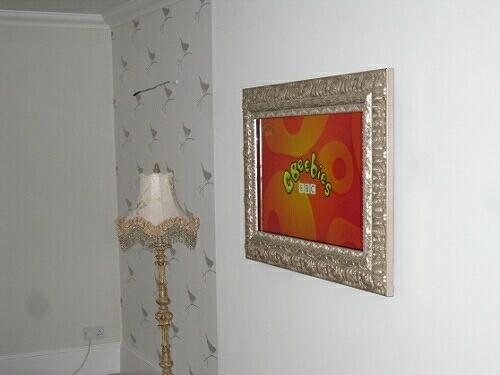 TV Framed in Sliver Leaf Picture Frame